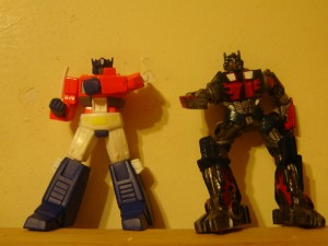 PVC Optimus and ROTF Prime: Prime is clearly calling Wheeljack for a special stand for his descendent.