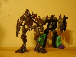 ROTF The Fallen versus PVC Overlord: No more bright colours for you.
