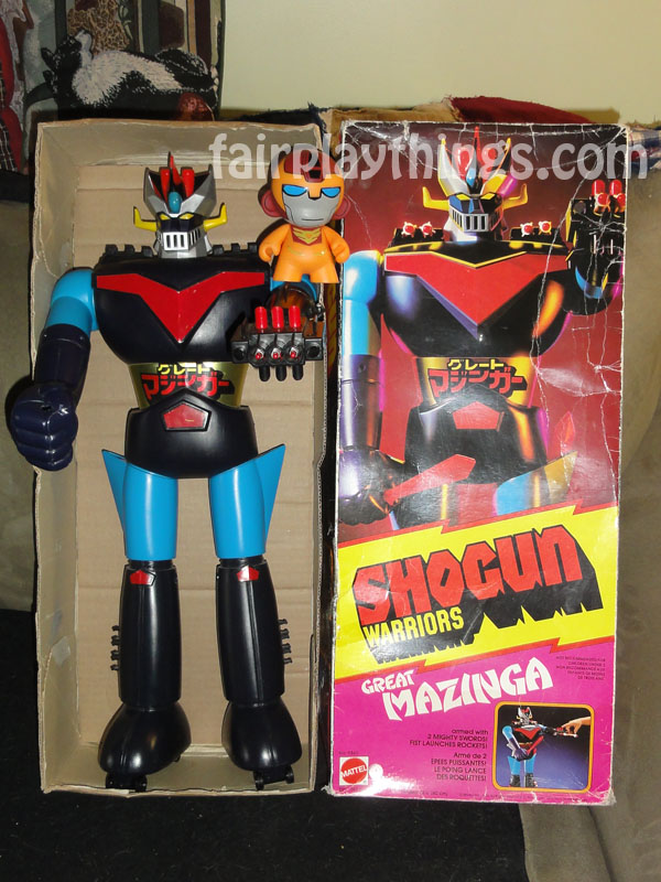 "If Great Mazinga is so great, why is his red chest plate not big enough to balance his new friend, 4"" Munny Rodimus?"